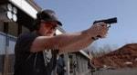 Ларри Викерс тестирует пистолет ПЛ-15К
